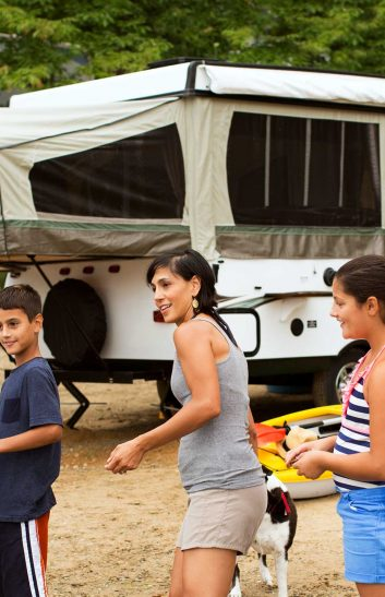 family with pop up camper